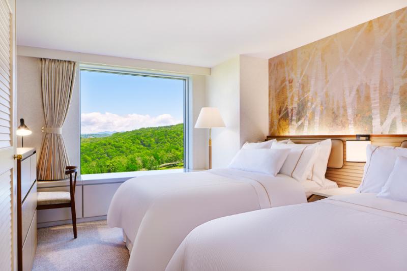 上階のベッドルームにシングルベッドを2台配置。快適な寝具で深い眠りをご提供します